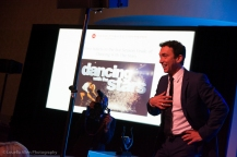 Bruno Tonioli presents tickets for Dancing with the Stars as an auction item.